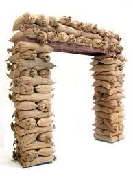 1940s themed party - sandbags are easy to assemble and this entryway is to-die for! Such a great idea for the luau theme :)
