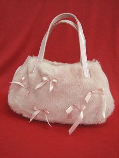 Emily Temple cute: Fur Ribbon bag in pink