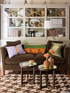 Brown Sofa - Design photos, ideas and inspiration. Amazing gallery of interior design and decorating ideas of Brown Sofa in living rooms, decks/patios, boy's rooms by elite interior designers. Decor, Furniture, Room, Interior, Purple Sofa, Family Room, Home, Living Room Orange, Brown Living Room