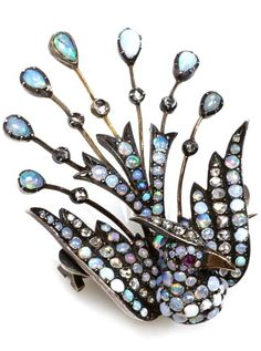 An opal, diamond and silver bird brooch measuring approximately: 2 x 1 1/2in.