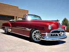 If this is not the most beautiful car I have ever seen, it has got to be close to it. The lines, the chrome, the stance, the paint, just a beautiful piece of rolling art. 1952 Pontiac Chieftan Silver Streak.