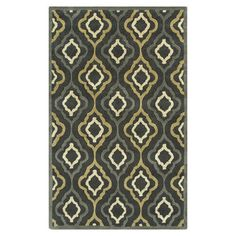 Hand-tufted wool and art silk rug with a quatrefoil motif.    Product: RugConstruction Material: Wool