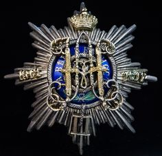 A Rare Russian Imperial Silver and Enamel Badge 1912 Commemorating the 100th anniversary of the Headquarters of the Guards and the St. Petersburg military