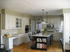 Oak cabinets with black island - Refinished and Refaced Cabinets and Kitchens by Telisa