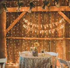 Rustic barn reception decorated with twinkle lights