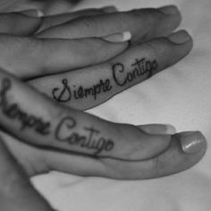 like this tattoo  Siempre Contigo means always with you! i would get it somewhere else tho=)