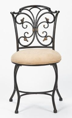 An ornate black and gold scrollwork back and plush sueded fabric seat give this vanity stool a glamorous feel. From Hillsdale Furniture.