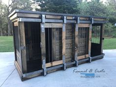 Luxury designer piece to replace your dogs' wire crate.  Handcrafted barn doors ! Perfect as an entry table or entertainment stand!  Large Double Dog kennel.  Indoor Double kennels come standard with center door that allows the space to be divided into two spaces  or latched back to completely keep kennel opened.  Can be ordered in custom distressed paint of your color choice. comes standard with stain and polyurethane.  It is furniture for your dog.