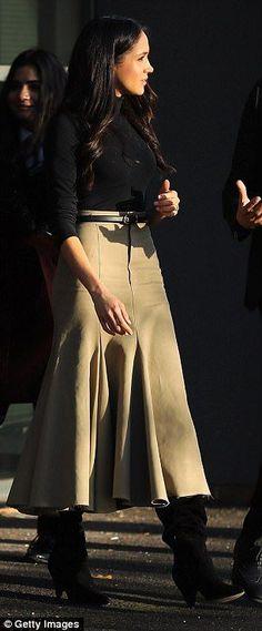 Meghan also showed off her camel skirt by British brand Joseph...