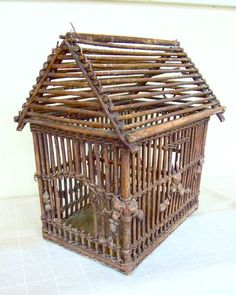 Vintage Wicker Bird Cage - interesting, I could do a decor piece like this, never thought of making a birdcage with twigs though - would prefer rough twigs to offset birds/flowers as part of #HomeDecor - leave more space between bars to make it decorative, rather than functional - decorate with flowers, butterflies, birds - #Crafts #Twig #Birdhouses