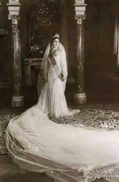 Queen Farida of Egypt in her wedding gown  What a long train