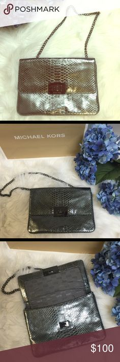 💯% Authentic MK Sloan Clutch, like new! Authentic Michael Kors Sloan Clutch in snakeskin leather, like new! Perfect for date nights! No dustbag, authenticity is shown in the last picture posted! Ships ASAP! Michael Kors Bags Clutches & Wristlets