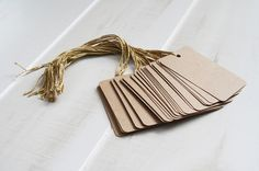 We have lots of extra paper buttons, ribbon, cardboard we can use to make our own gift tags this year!
