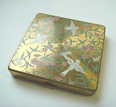 Painted and brass compact