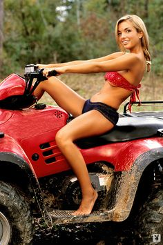 Kimberly Holland getting muddy on an ATV