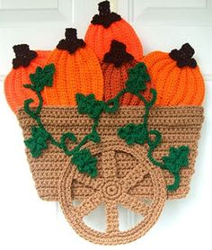 Do you love Fall??? You will have so much fun making this wagon and filling it with your crocheted pumpkins. It reminds me of riding around in the Fall and seeing Pumpkin patches in fields everywhere. You can make one for each door and any visitors that come through will absolutely love your unique Fall Door Hanging!!!! It is made from worsted weight yarn and works up quickly!!!