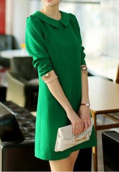 emerald green dress with flat collar and beige cuffs