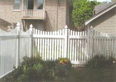 Vinyl fence and corner garden.
