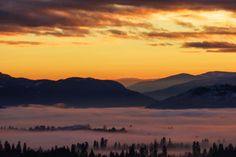 A soft blanket of cloud covers the city. Vernon, BC. Photo by Christa Lee Photography