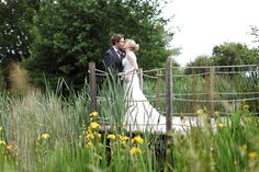Wonderful Worcestershire Wedding at the Avoncroft Museum (www.avoncroft.org.uk). Romantic photo on the jetty. David Perkins photographer.  #WedWithTed @tedbaker