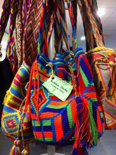 Colombian bags in a traditional style but modern use of colours by Buena Onda http://www.thebuenaonda.com.