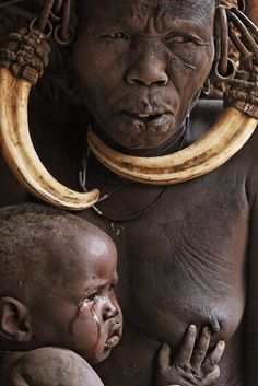 Africa | A Mursi woman and child in village of Galap. Omo Valley, Ethiopia | ©Randy Olson