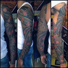 Water and blossoms sleeve tattoo