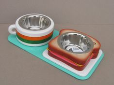 This dog bowl stand is carefully handcrafted to details. The height of the stand is 7,5 cm and is free standing. This holder is for two bowls, bowl diameter is 11 cm. Quality stainless steel bowls are dishwasher safe. Production method: This pet bowl stand is hand made, cut out of wood