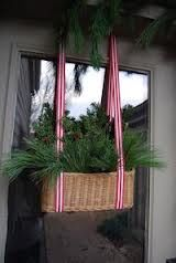Christmas Door idea. Basket filled with holly or tree trimmings! This would be cute inside too!