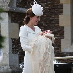 mirror:  Christening of Princess Charlotte of Cambridge, July 5, 2015-Duchess of Cambridge holds her daughter Princess Charlotte, wearing the replica of the Royal Christening dress, prepare to enter St. Mary Magdalene's Church