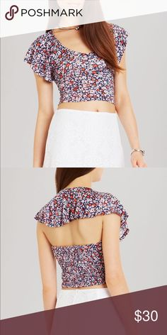 BCBG Ruffle Crop top 🔹New w/Tags🔹 PRODUCT DETAILS Imagine a summer of flower crowns, indie tunes, festival grounds and this floral crop top from BCBGeneration.  Rayon/spandex; lining: polyester Machine wash or dry clean Imported V-neck, ruffled cap sleeves, floral print Cutout back, smocked back, cropped BCBGeneration Tops Crop Tops