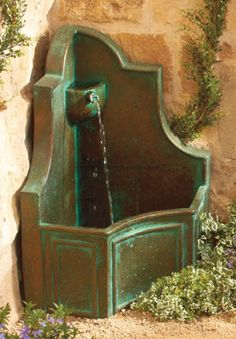 Add a fountain to your backyard to give it a gorgeous garden feel.