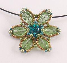 Spring Flower is a quick easy project that can be finished in very little time! The sparkle of the flower adds an impact to any outfit and can be worn with blue jeans or for a special occasion! This is a downloadable pdf instruction packet for Spring Flower Pendant. My instructions are easy to follow with lots of photos for those of us who are visual learners. This packet includes 6 pages of detailed step by step instructions and a material list.  Materials: Swarovski #1028 39ss chaton…