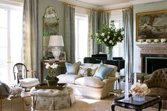 Soft blues and creams crates a serene mood in this elegant living room - Traditional Home® / Photo: John Bessler / Design: Janet Simon