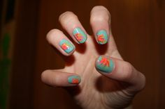 kaitmarie:    I got my nails done yesterday. I'd only had them done twice before. I asked for flowers. I don't really think they look like flowers, but I love them. Its like a fiesta on my fingers.