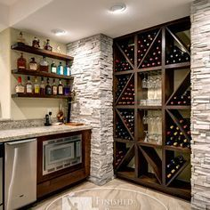 Wine storage and small bar for basement; by Finished Basement Company Basement Renovations, Home Remodeling, Finished Basement Company, Basement Bar Designs, Cool Basement Ideas, Rustic Basement Bar, Wet Bar Basement, Basement Kitchenette, Basement Layout