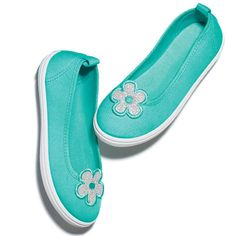This sweet ballet flat is ideal for all of her special occasions. Cotton canvas, man-made materials. Imported.Half sizes order up.While supplies last.