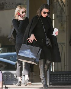 Emma Roberts and Lea Michele were spotted shopping at Barneys New York on Friday in the sa...