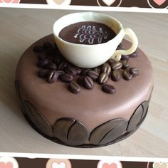 Coffee themed cake Cup and beans made with chocolate-this would be fun for Dad's bday.