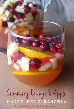 Cranberry, Orange & Apple White Wine Sangria | Dry Riesling sweetened with raw honey, then mixed with 100% tart cranberry juice, brandy and popular fall fruits such as apple, orange and cranberry.  @therisingspoon