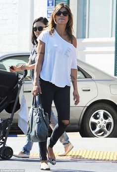 She's snapped back! The Italian model looked trim as she popped to the shops on Tuesday in...