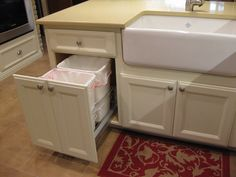 Pullout trash & recycling cabinet ---- add drawer with cutting board with hole over can