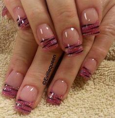 Pink and black nail tips.