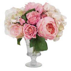 Faux cabbage rose and hydrangea arrangement in a glass pedestal vase.  Product: Faux floral arrangementConstruction Mater...