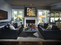 Two Leather Sofas Nestle Near A Cozy Fireplace In This Retro HGTV Dream  Home 2009 Room.