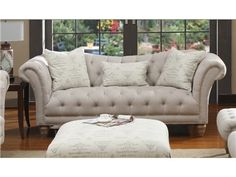 """Big and comfy is how we like 'em. Let us help you find your dream couch! The Hutton Linen Sofa features linen-look fabric with """"Parisian Café"""" print on pillows. #stylemyhome"""