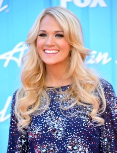 Carrie Underwood long cascading curls  http://www.hairstyleagain.com/hair-style-beauty/womens-long-curly-hairstyles/#