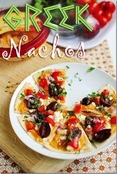 Greek Nachos combine classic Greek Salad ingredients on homemade tortilla chips! | iowagirleats.com