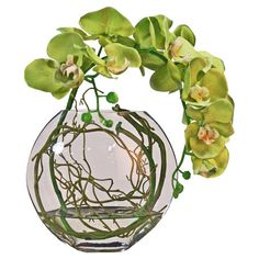 Brimming with natural appeal, this lovely faux phalaenopsis orchid is nestled in a glass bowl vase, perfect for your mantel or credenza.   ...