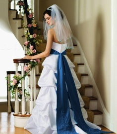 I love the marine blue sash (available at David's Bridal in a bunch of colors!).  But where to wear it on my dress?